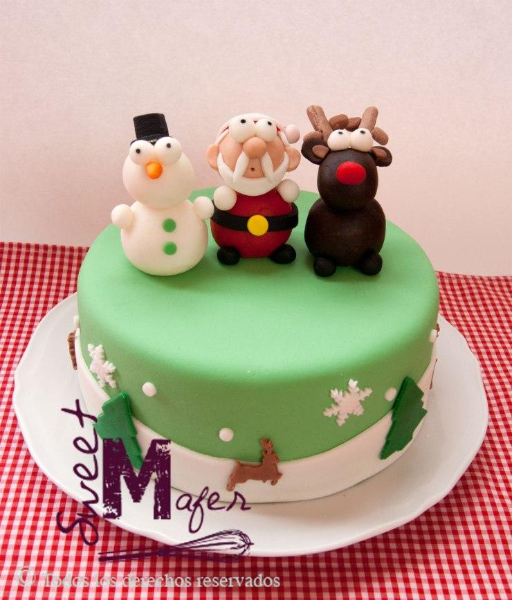 Torta con Santa, snowman y reno moldeados, disponible en 10 y 15 porciones. En masas de cake negro de navidad, chocolate, vainilla, marmolada.