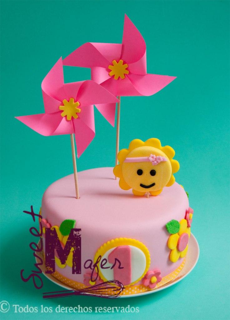 Torta primer año con sol flores y ringletes